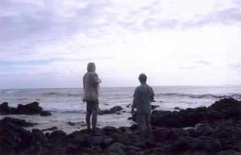Brother Noland and John Stokes look out from Halona Point toward Moloka'i