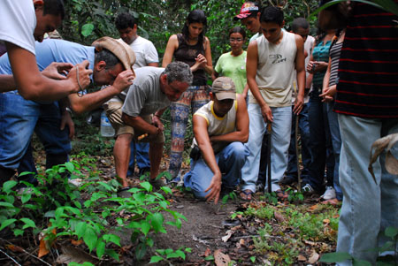 Florencio points out paca tracks on the rainforest trail