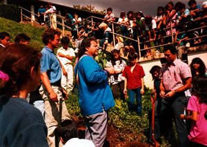 John, Jake, Kahele Kukea and the Kamehameha Schools grade 5 students plant the yellow milo tree in 1990.